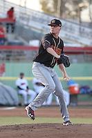 Sam Howard (32) of the Modesto Nuts pitches against the High Desert Mavericks at Heritage Field on June 3, 2016 in Adelanto, California. Modesto defeated High Desert, 2-1. (Larry Goren/Four Seam Images)