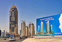 Dubai Marina, Jumeirah Residences construction site, the Grosvenor House Hotel and developer?s hoarding advertising another residential development for sale.  Dubai. United Arab Emirates.