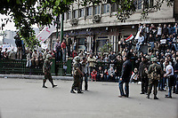 Protesters remonstrate with soldiers at one of the entrances to Tahrir Square. Continued anti-government protests take place in Cairo calling for President Mubarak to stand down. After dissolving the government, Mubarak still refuses to step down from power.