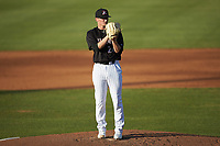 Kannapolis Intimidators starting pitcher Davis Martin (24) looks to his catcher for the sign against the Hickory Crawdads at Kannapolis Intimidators Stadium on May 6, 2019 in Kannapolis, North Carolina. The Crawdads defeated the Intimidators 2-1 in game one of a double-header. (Brian Westerholt/Four Seam Images)