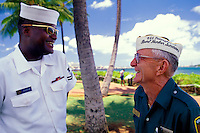 Tour Guide and Pearl Harbor survival speaks with a visitor to Pearl Harbor