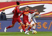 Genoa's Marko Pjaca, right, is challenged by Roma's Gianluca Mancini, center, and Roma's Chris Smalling during the Italian Serie A Football match between Roma and Genoa at Rome's Olympic stadium, March 7, 2021.<br /> UPDATE IMAGES PRESS/Riccardo De Luca