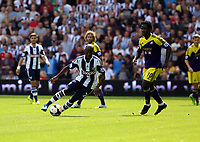 Pictured L-R: Billy Jones of West Brom swings past Wilfried Bony of Swansea. Sunday 01 September 2013<br /> Re: Barclay's Premier League, West Bromwich Albion v Swansea City FC at The Hawthorns, Birmingham, UK.