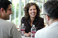 """Kathy Cramer Walsh, assistant professor of political science, talks with friends in the Lakefront Cafe in Memorial Union. Cramer Walsh is author of """"Talking about Politics: Informal Groups and Social Identity in American Life,"""" published by the University of Chicago Press in 2003, in which she explores the link between political beliefs and social identity. With Cramer Walsh are assistant professor of political science Jason Wittenberg (left) and associate professor of political science Joe Soss.<br /> <br /> Client: University of Wisconsin-Madison<br /> © UW-Madison University Communications 608-262-0067<br /> Photo by: Michael Forster Rothbart<br /> Date:  7/04    File#:   D100 digital camera frame 5562."""
