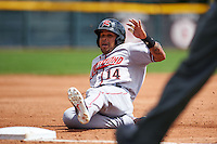 Richmond Flying Squirrels outfielder Javier Herrera (14) slides into third during a game against the Erie Seawolves on May 20, 2015 at Jerry Uht Park in Erie, Pennsylvania.  Erie defeated Richmond 5-2.  (Mike Janes/Four Seam Images)