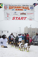 Brent Sass and team leave the ceremonial start line at 4th Avenue and D street in downtown Anchorage during the 2013 Iditarod race. Photo by Jim R. Kohl/IditarodPhotos.com