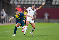 KASHIMA, JAPAN - JULY 27: Steph Catley #7 of Australia and Lynn Williams #21 of USA battle for a ball during a game between Australia and USWNT at Ibaraki Kashima Stadium on July 27, 2021 in Kashima, Japan.