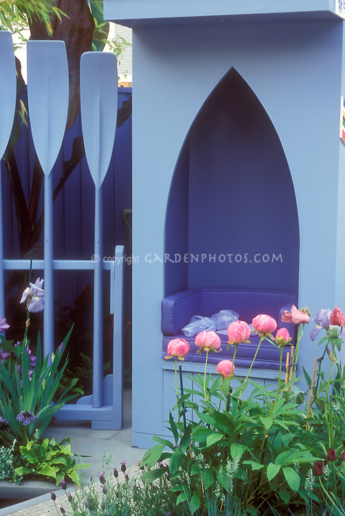 Using boat paddles to create whimsical fence, recycling, flea market finds, with pink and blue color theme, irises, clematis vine, pink peonies