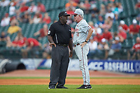 Florida State Seminoles head coach Mike Martin talks with second base umpire Troy Fullwood against the Louisville Cardinals in Game Eleven of the 2017 ACC Baseball Championship at Louisville Slugger Field on May 26, 2017 in Louisville, Kentucky. The Seminoles defeated the Cardinals 6-2. (Brian Westerholt/Four Seam Images)