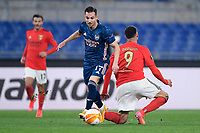 18th February 2021, Rome, Italy;  Cedric of Arsenal FC competes for the ball with Alexandre Lacazette during the UEFA Europa League round of 32 Leg 1 match between SL Benfica and Arsenal at Stadio Olimpico, Rome, Italy on 18 February 2021.