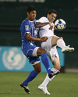 Santino Quaranta #20 of the USA shields the ball from Mariano Acevedo #11 of Honduras during a CONCACAF Gold Cup match at RFK Stadium on July 8 2009 in Washington D.C.