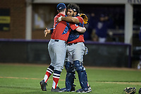 NJIT Highlanders relief pitcher Bryan Haberstroh (7) gets a hug from catcher Edgar Badaraco (28) after closing out the win against the High Point Panthers during game two of a double-header at Williard Stadium on February 18, 2017 in High Point, North Carolina.  The Highlanders defeated the Panthers 4-2.  (Brian Westerholt/Four Seam Images)