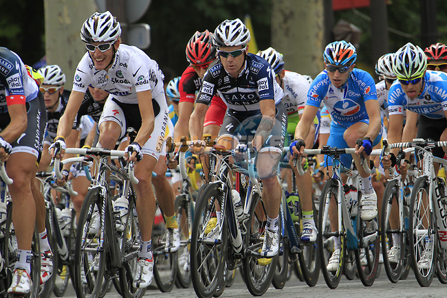 The peloton including White Jersey leader Andy Schleck (LUX) Saxo Bank speeds down the Champs-Elysees during the final Stage 20 of the 2010 Tour de France running 102.5km from Longjumeau to Paris Champs-Elysees, France. 25th July 2010.<br /> (Photo by Eoin Clarke/NEWSFILE).<br /> All photos usage must carry mandatory copyright credit (© NEWSFILE | Eoin Clarke)