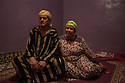 """Morocco - Ouarzazate - Naceur Oujri, 71, portrayed together with his wife, Fatima el Ghazlani, 61, in their house located in the Kasbah Taourirt of Ouarzazate. Oujri first appeared as an extra in 1962 blockbuster Lawrence of Arabia and later became the personal assistant in Morocco of Italian director Pier Paolo Pasolini, earning a brief role in his 1967 movie Oedhipus Rex.  Since then he has appeared in countless movies and has recently been recognized as an official actor in Morocco. """"The most fun I had was in 2000, when they shot Rules of Engagement"""" a movie set in Yemen and starring Samuel L. Jackson and Tommy Lee Jones. """"The production had to hire the whole Kasbah in order to stage an attack against the American embassy in Sana'a. Hundreds of us attacked it, while the US Army was firing missiles and bombs at us"""" he remembers laughing."""