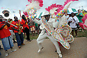 Secondliners and brass bands perform at the New Orleans Jazz and Heritage Festival, Friday, April 23. 2010...(AP Photo/Cheryl Gerber)