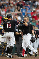 Texas Tech Red Raiders second baseman Brian Klein (5) is greeted by teammate Josh Jung (16) after hitting a home run during Game 1 of the NCAA College World Series against the Michigan Wolverines on June 15, 2019 at TD Ameritrade Park in Omaha, Nebraska. Michigan defeated Texas Tech 5-3. (Andrew Woolley/Four Seam Images)