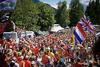 experiencing the craziness at the Dutch Corner (nr7) up Alpe d'Huez; 1 hour before the race passes by this is just an orange pop-up street party<br /> <br /> stage 20: Modane Valfréjus - Alpe d'Huez (111km)<br /> 2015 Tour de France