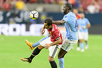 Houston, TX - Thursday July 20, 2017: Henrikh Mkhitaryan and Yaya Touré during a match between Manchester United and Manchester City in the 2017 International Champions Cup at NRG Stadium.