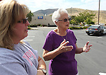 Witnesses Kathy Chaney and her mother Ethlyn MacDonald talk outside the IHOP restaurant in Carson City, Nev., on Wednesday, Sept. 7, 2011. They were in the restaurant Tuesday when gunman Eduardo Sencion opened fire with an AK-47, killing four people and injuring seven others. (AP Photo/Cathleen Allison)