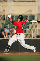 Brett Austin (20) of the Kannapolis Intimidators follows through on his swing against the Greensboro Grasshoppers at CMC-Northeast Stadium on August 1, 2015 in Kannapolis, North Carolina.  The Intimidators defeated the Grasshoppers 7-4.  (Brian Westerholt/Four Seam Images)