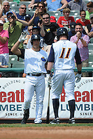 Trenton Thunder outfielder Slade Heathcott (11) hits a home run and is greeted by Mark Teixeira (25) during game against the Erie SeaWolves at ARM & HAMMER Park on May 29 2013 in Trenton, NJ.  Trenton defeated Erie 3-1.  Tomasso DeRosa/Four Seam Images