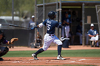 San Diego Padres shortstop Gabriel Arias (65) follows through on his swing during an Extended Spring Training game against the Colorado Rockies at Peoria Sports Complex on March 30, 2018 in Peoria, Arizona. (Zachary Lucy/Four Seam Images)