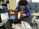 A student works on the 3D printer.