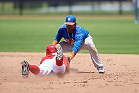 GCL Mets second baseman David Lozano (11) puts a tag on Landerson Pena (7) as he slides into second base during a game against the GCL Nationals on August 4, 2018 at FITTEAM Ballpark of the Palm Beaches in West Palm Beach, Florida.  GCL Nationals defeated GCL Mets 7-4.  (Mike Janes/Four Seam Images)