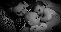 """COPY BY TOM BEDFORD<br /> Pictured: Pearl Black (R) with mum Gemma (L) and baby brother (C)<br /> Re: The funeral of a toddler who died after a parked Range Rover's brakes failed and it hit a garden wall which fell on top of her will be held today at Merthyr Tydfil.<br /> One year old Pearl Melody Black and her eight-month-old brother were taken to hospital after the incident in south Wales.<br /> Pearl's family, father Paul who is The Voice contestant and mum Gemma have said she was """"as bright as the stars""""."""