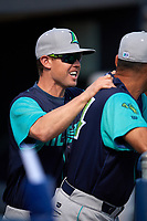 Lynchburg Hillcats hitting coach Justin Toole (2) jokes with manager Rouglas Odor (24) in the dugout before the first game of a doubleheader against the Frederick Keys on June 12, 2018 at Nymeo Field at Harry Grove Stadium in Frederick, Maryland.  Frederick defeated Lynchburg 2-1.  (Mike Janes/Four Seam Images)
