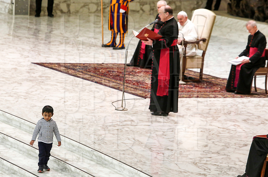 A child walks on the floor as Pope Francis attends his weekly general audience in the Paul VI hall at the Vatican, January 22, 2020.<br /> <br /> UPDATE IMAGES PRESS/Riccardo De Luca<br /> <br /> STRICTLY ONLY FOR EDITORIAL USE