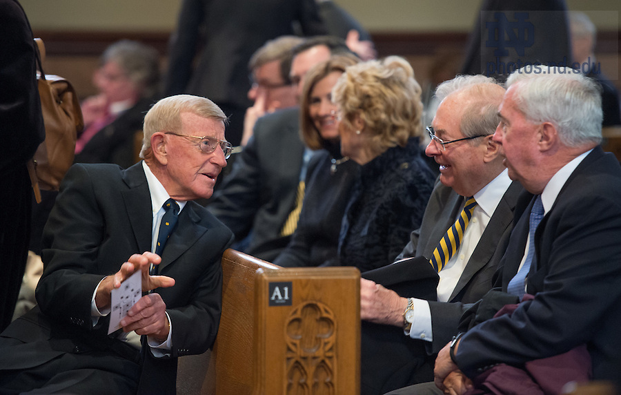 Mar. 4, 2015; Former football coach Lou Holtz chats before the funeral of President Emeritus Rev. Theodore M. Hesburgh, C.S.C. in the Basilica of the Sacred Heart. (Photo by Barbara Johnston/University of Notre Dame)