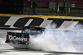 NASCAR Camping World Truck Series<br /> North Carolina Education Lottery 200<br /> Charlotte Motor Speedway, Concord, NC USA<br /> Friday 19 May 2017<br /> Kyle Busch, Cessna Toyota Tundra celebrates his win with a burnout<br /> World Copyright: Nigel Kinrade<br /> LAT Images<br /> ref: Digital Image 17CLT1nk05249