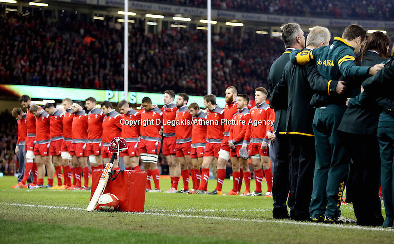 Pictured: Wales players bow their heads down in tribute to cricketer Phillip hughes Saturday 29 November 2014<br /> Re: Dove Men Series 2014 rugby, Wales v South Africa at the Millennium Stadium, Cardiff, south Wales, UK.