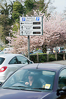 Illuminated signs give motorists up to date information on how many spaces are available in the town.  The information is updated by radio.  The aerials are just visible at the tops of the large displays.