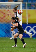 USWNT captain (3) Christie Rampone goes up for a header against New Zealand forward (15) Emma Kete while playing at Wulihe Stadium.  The USWNT defeated New Zealand, 4-0, during the 2008 Beijing Olympics in Shenyang, China.  With the win, the USWNT won group G and advanced to the semifinals.