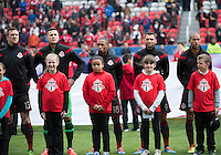 Toronto, Ontario - May 3, 2014: Toronto FC players stand for the national anthems during the opening ceremonies in a game between the New England Revolution and Toronto FC at BMO Field.<br />