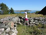 Child Climbing on Stonewall on Island of Kökar, Åland, Finland
