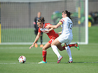 Boyds MD - April 13, 2014: Jodie Taylor (14) of the Washington Spirit  goes against Brittany Taylor (13) of the Western New York Flash. The Western New York Flash defeated the Washington Spirit 3-1 in the opening game of the 2014 season of the National Women's Soccer League at the Maryland SoccerPlex.