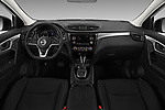 Stock photo of straight dashboard view of 2017 Nissan Rogue Sport S 5 Door SUV