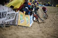 Michael Vanthourenhout (BEL/Sunweb-Napoleon Games) crashes into the barriers <br /> <br /> Duinencross Koksijde WorldCup 2015