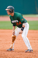Yasmani Grandal #24 of the Miami Hurricanes takes his lead off of second base against the Boston College Eagles at the 2010 ACC Baseball Tournament at NewBridge Bank Park May 27, 2010, in Greensboro, North Carolina.  The Eagles defeated the Hurricanes 12-10 in 10 innings.  Photo by Brian Westerholt / Four Seam Images