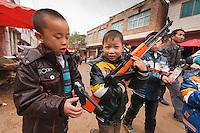 Asia,Cina,Guizhou,Gulong festival of Lusheng of Miao people,children war playng ,China minority