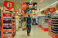 Shoppers at the Cardiff  branch of Sainsbury supermarket at self service tills. Cardiff, UK.  Sainsbury is the third largest supermarket in the UK. 18-Sept-2012.