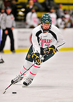 29 January 2012: University of Vermont Catamount defenseman Delia McNally, a Freshman from Glean Head, New York, in action against the University of New Hampshire Wildcats at Gutterson Fieldhouse in Burlington, Vermont. The Lady Cats, dressed in their Breast Cancer Awareness jerseys, edged out the Wildcats 2-1 to split their Hockey East twin-game weekend series. Mandatory Credit: Ed Wolfstein Photo