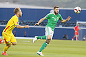Romania's  Alexandru Maxim gives chase Northern Ireland's Stuart Dallas during the UEFA EURO 2016 qualifying Group F soccer match between Northern Ireland and Romania at Windsor Park in Belfast, Northern Ireland, 13 June 2015.  EPA/PauL McErlane