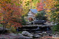 Babcock State Park, West Virginia, USA - Glade Creek Grist Mill, surrounded by fall colors.  Completed in 1976, this operating grist mill stands near the site of a former mill known as Cooper's Mill.