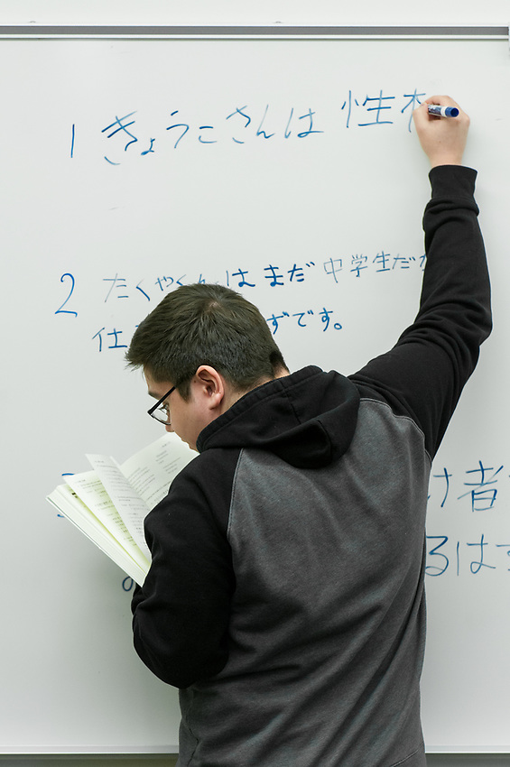 Matthew Dimatulac writes his answer on the board as Japanese Professor Hiroko Harada teaches second year Japanese  (JPN 202) in Beatrice McDonald Hall.