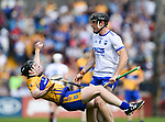 Tony Kelly of Clare is floored by Kevin Moran of Waterford, leading to a red card for the latter during their Munster  championship round robin game at Cusack Park Photograph by John Kelly.