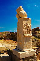 Column with phallus at the Stoivadeion in the Temple of Dionysus at the ruins of the Greek city of Delos, Greek Cyclades Islands.